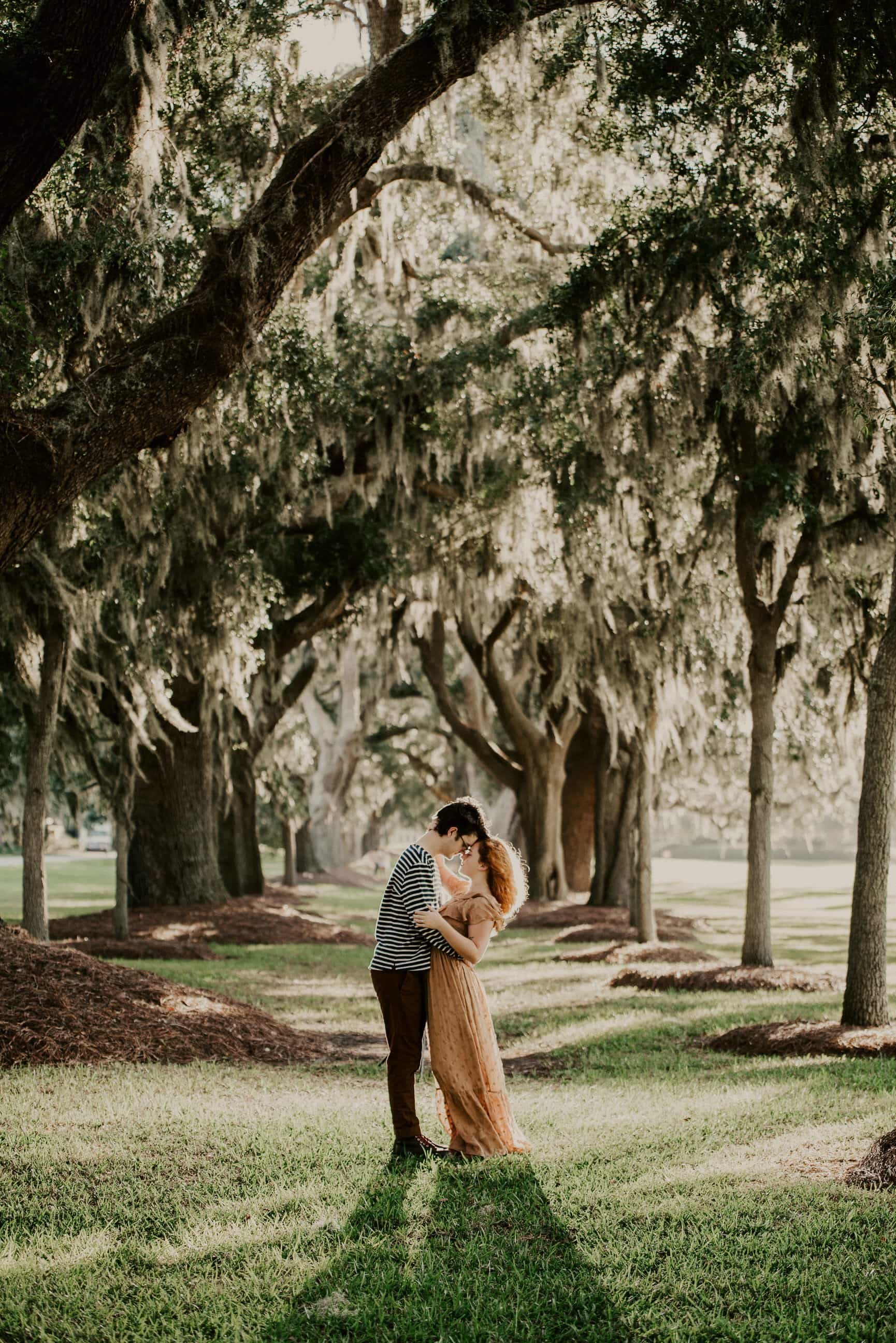Close embrace under oaks at Avenue of the Oaks