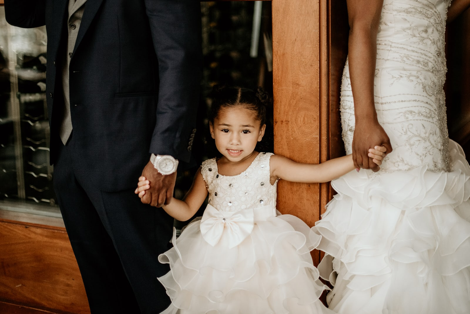 Bride and groom with daughter in between prior to first look