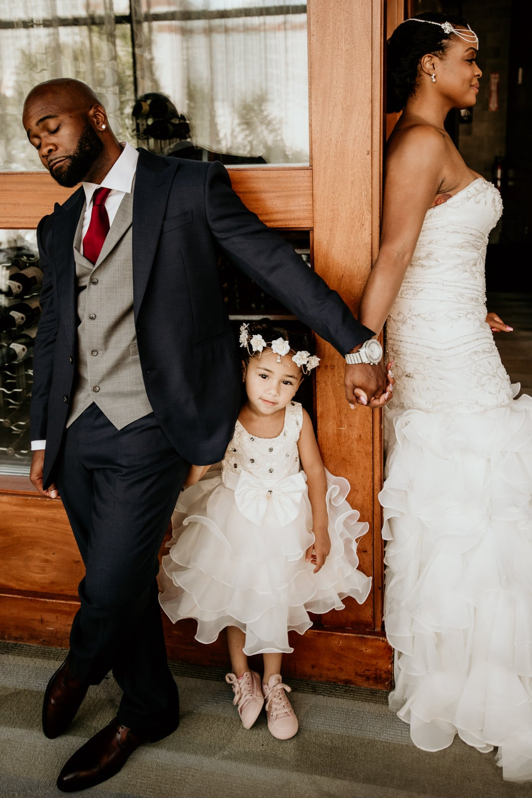 Daughter hiding behind her father before the first look