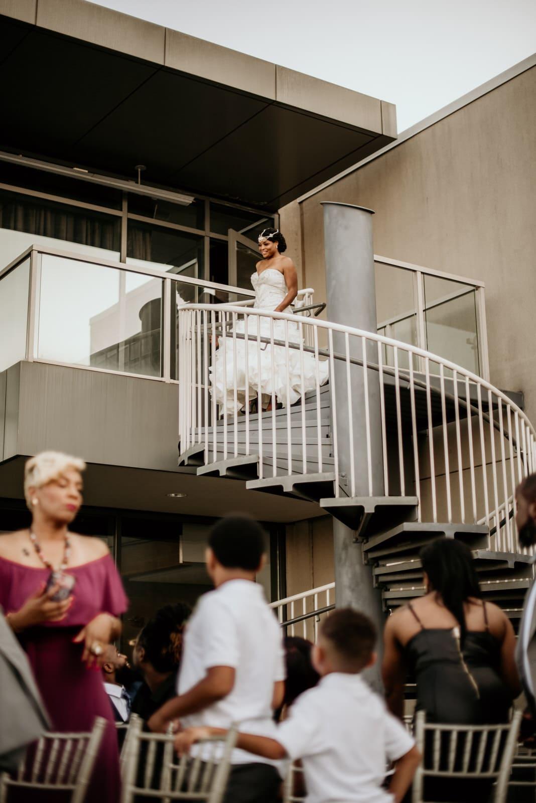 Bride descending the spiral staircase at Ventanas